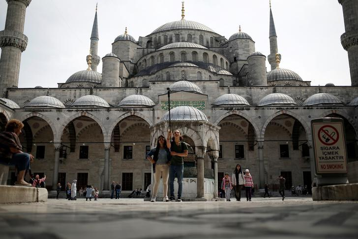 Tourists visit the Ottoman-era Sultanahmet mosque, also known as the Blue Mosque, in Istanbul, Turkey, April 17, 2017. REUTERS/Alkis Konstantinidis