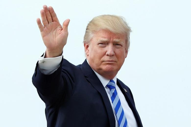 U.S. President Donald Trump waves as he boards Air Force One at Joint Base Andrews outside Washington, U.S., before traveling to Palm Beach, Florida for the Good Friday holiday/Easter weekend, April 13, 2017. REUTERS/Yuri Gripas