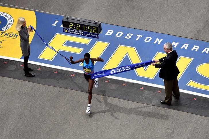 Apr 17, 2017; Boston, MA, USA; Edna Kiplagat crosses the finish line of the 2017 Boston Marathon winning the women's division. Brian Fluharty-USA TODAY Sports