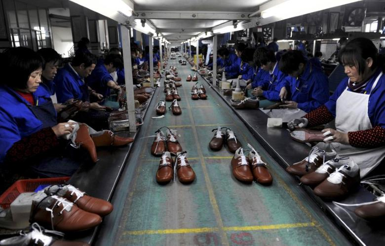 FILE PHOTO - Employees work at a shoe factory in Lishui, Zhejiang province, January 24, 2013. REUTERS/Lang Lang