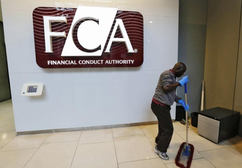 A maintenance worker cleans the entrance area of the headquarters of the new Financial Conduct Authority (FCA) in the Canary Wharf business district of London April 1, 2013. REUTERS/Chris Helgren