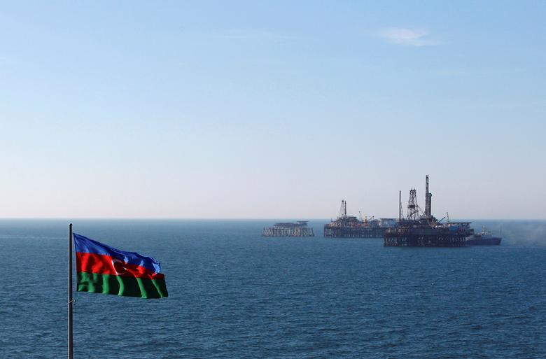 FILE PHOTO: The state flag of Azerbaijan flutters in the wind on an oil platform in the Caspian Sea east of Baku, Azerbaijan, January 22, 2013. REUTERS/David Mdzinarishvili/File Photo