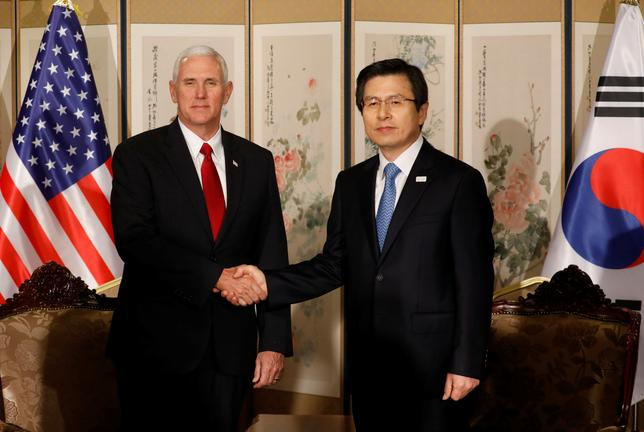 U.S. Vice President Mike Pence shakes hands with acting South Korean President and Prime Minister Hwang Kyo-ahn in Seoul.  REUTERS/Kim Hong-Ji