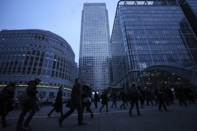 FILE PHOTO: Workers walk to work during the morning rush hour in the financial district of Canary Wharf in London, Britain, January 26, 2017.  REUTERS/Eddie Keogh
