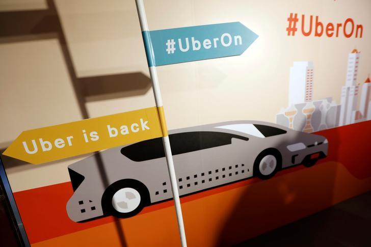 A sign is seen during a news conference to announce Uber resumes ride-hailing service, in Taipei, Taiwan April 13, 2017. REUTERS/Tyrone Siu/Files