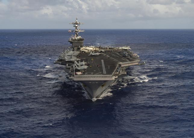 DAY 80 / APRIL 9: A U.S. Navy strike group will be moving toward the western Pacific Ocean near the Korean peninsula as a show of force, a U.S. official told Reuters, as concerns grow about North Korea's advancing weapons program.Earlier this month North Korea tested a liquid-fueled Scud missile which only traveled a fraction of its range.The strike group, called Carl Vinson, includes an aircraft carrier and will make its way from Singapore toward the Korean peninsula, according to the official, who was not authorized to speak to the media and requested anonymity.''We feel the increased presence is necessary,'' the official said, citing North Korea's worrisome behavior. U.S. Navy Photo by Mass Communication Specialist 3rd Class Tom Tonthat/Handout via Reuters