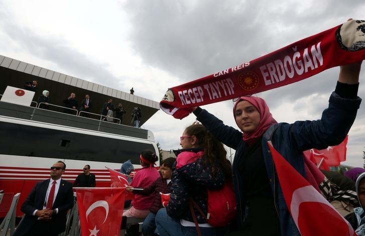 Turkish President Tayyip Erdogan addresses his supporters upon his arrival at Esenboga Airport in Ankara, Turkey April 17, 2017. REUTERS/Stringer