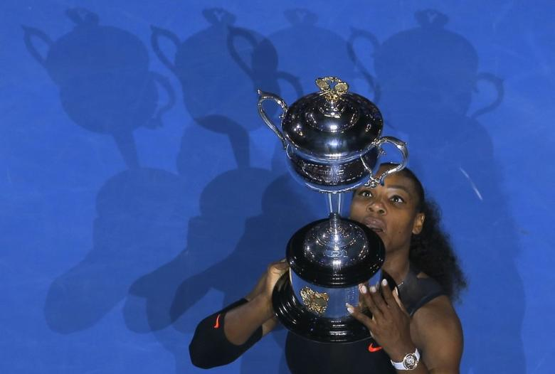 Tennis - Australian Open - Melbourne Park, Melbourne, Australia - 28/1/17 Serena Williams of the U.S. holds her trophy after winning her Women's singles final match against Venus Williams of the U.S. .REUTERS/Jason Reed