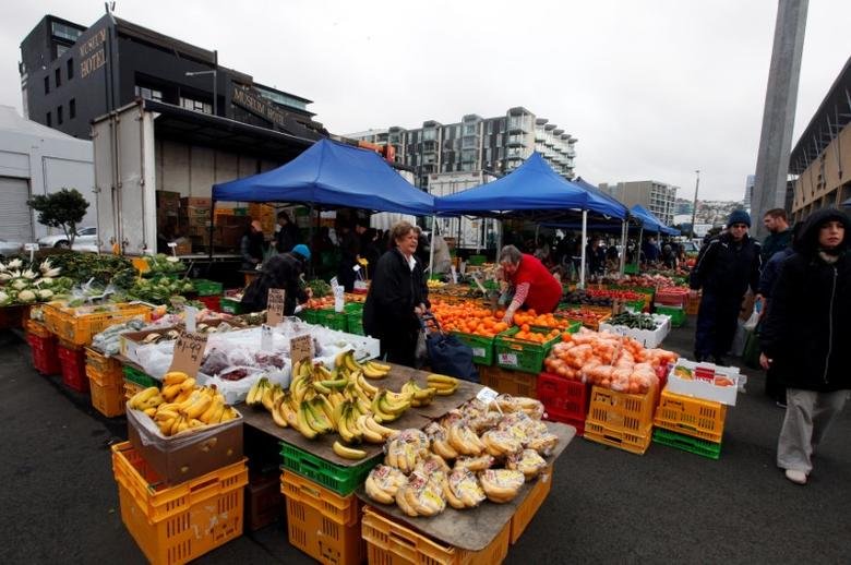 People buy fruits at a fruit and vegetable market in front of the Te Papa Museum in Wellington October 2, 2011.   REUTERS/Jacky Naegelen/File Photo