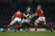 South Africa's Rohan Janse van Rensburg is tackled by Wales' Scott Williams and Ross Moriarty  Action Images via Reuters / Paul Childs Livepic