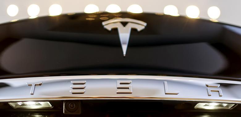 FILE PHOTO: A Tesla logo adorns a 'Model S' car in the dealership in Berlin, Germany, November 18, 2015. REUTERS/Hannibal Hanschke/File Photo