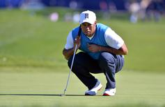 Tiger Woods lines up a putt on the 1st green during the first round of the Farmers Insurance Open golf tournament at Torrey Pines Municipal Golf Course. Mandatory Credit: Orlando Ramirez-USA TODAY Sports/File Photo