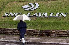 A pedestrian walks past the SNC-Lavalin Group Inc., headquarters in Montreal, May 7, 2009.  REUTERS/Christinne Muschi