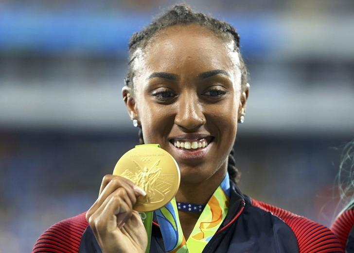 2016 Rio Olympics - Athletics - Victory Ceremony - Women's 100m Hurdles Victory Ceremony - Olympic Stadium - Rio de Janeiro, Brazil - 18/08/2016. Gold medalist Brianna Rollins (USA) of USA poses. REUTERS/Leonhard Foeger