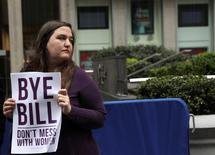 A protestor from the National Organization for Women of New York (NOW-NYC) holds a protest in front of Fox News Channel and the News Corporation Headquarters, following the firing of Bill O'Reilly, in New York City, U.S. April 20, 2017. REUTERS/Shannon Stapleton