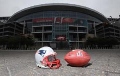 FILE PHOTO - Feb 4, 2017; Houston, TX USA; General overall view of New England Patriots helmet and Wilson NFL official Duke Super Bowl LI logo football at NRG Stadium. Mandatory Credit: Kirby Lee-USA TODAY Sports