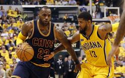 Apr 20, 2017; Indianapolis, IN, USA; Cleveland Cavaliers forward LeBron James (23) drives to the basket against Indiana Pacers forward Paul George (13) in game three of the first round of the 2017 NBA Playoffs at Bankers Life Fieldhouse. Cleveland defeats Indiana 119-114. Mandatory Credit: Brian Spurlock-USA TODAY Sports