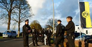 Police near the site before German forensic experts reconstruct the Borussia Dortmund team bus attack near Dortmund, Germany on April 18, 2017, one week after the bus was hit by an explosion near the team hotel before their Champions League game against Monaco.     REUTERS/Thilo Schmuelgen