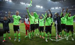Ajax players celebrate after the match  Reuters / Thilo Schmuelgen Livepic