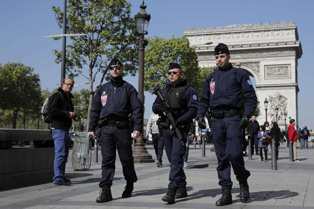 French CRS police patrol the Champs Elysees Avenue the day after a policeman was killed and two others were wounded in a shooting incident in Paris, France, April 21, 2017. REUTERS/Benoit Tessier