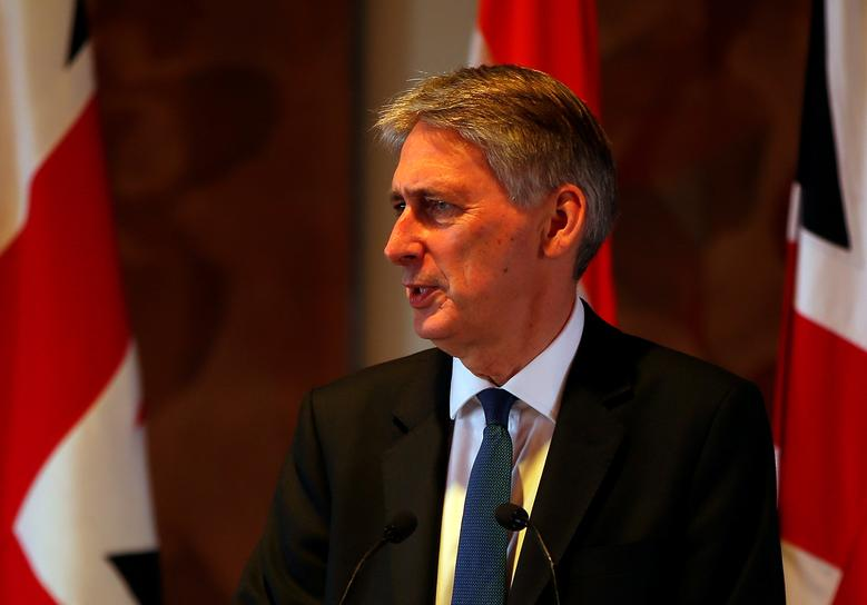Britain's Chancellor of the Exchequer Philip Hammond speaks during a joint news conference with India's Finance Minister Arun Jaitley in New Delhi, India April 4, 2017. REUTERS/Altaf Hussain