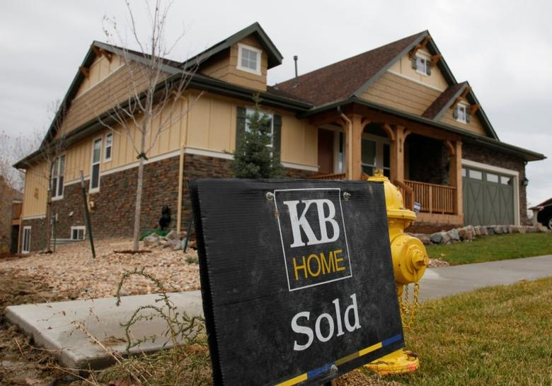 A sold sign is seen outside a house built by KB Home in Golden, Colorado, United States October 27, 2009.   REUTERS/Rick Wilking/File Photo