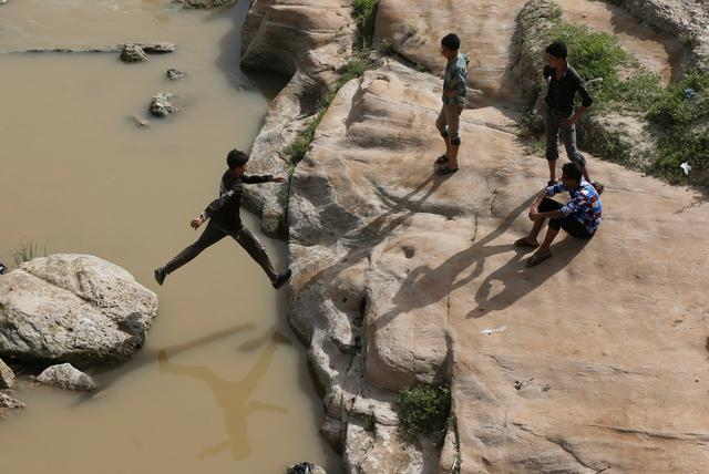 Iraqi youths enjoy their Friday holiday at Shallalat district (Arabic for ''waterfalls'') in eastern Mosul, Iraq, April 21, 2017. REUTERS/ Muhammad Hamed