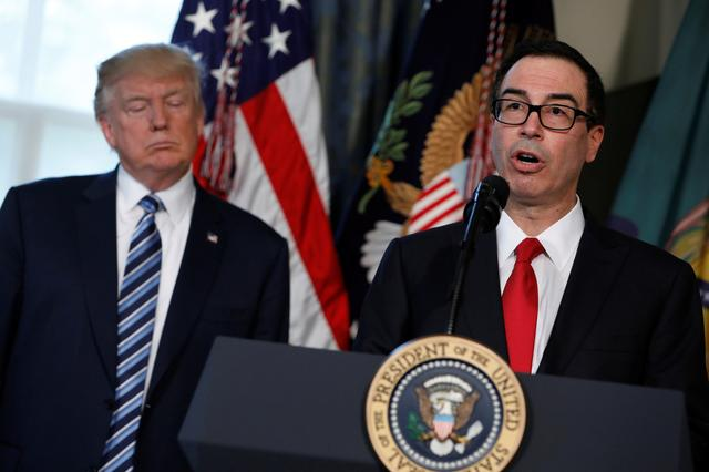 Treasury Secretary Steve Mnuchin speaks during a signing ceremony with President Donald Trump at the Treasury Department in Washington, U.S., April 21, 2017.  REUTERS/Aaron P. Bernstein