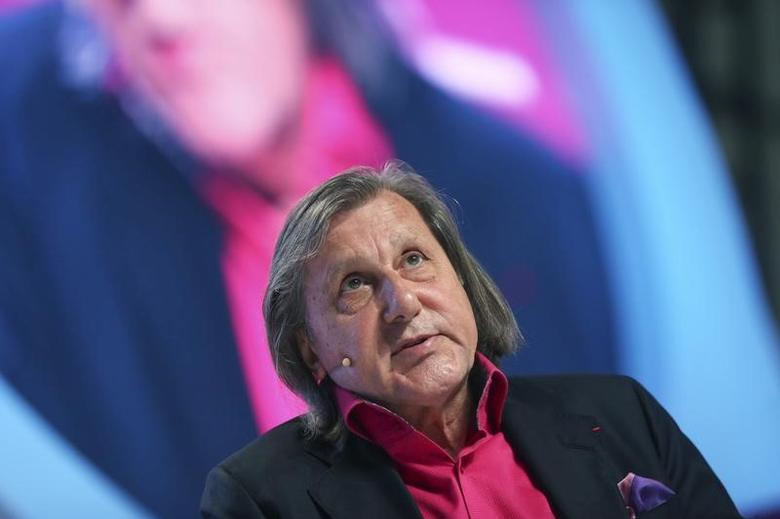 Former world No.1 professional tennis player Ilie Nastase of Romania speaks during the Doha GOALS forum in Doha December 11, 2013. The forum aims to create initiatives for global progress through sports. REUTERS/Fadi Al-Assaad/Files