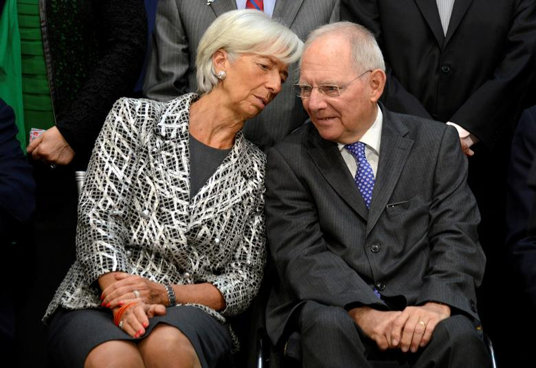 IMF Managing Director Christine Lagarde (L) chats with German Finance Minister Wolfgang Schauble as they take their seats for a ''family'' photo for the International Monetary and Financial Committee (IMFC), as part of the IMF and World Bank's 2017 Annual Spring Meetings, in Washington, U.S., April 22, 2017.   REUTERS/Mike Theiler
