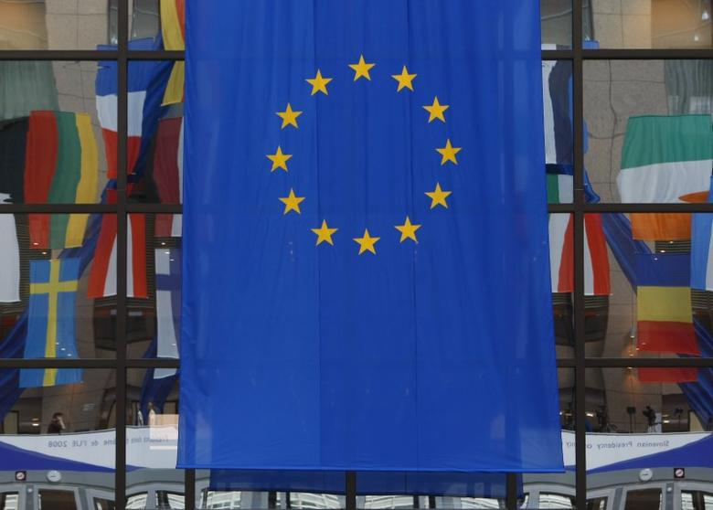 Flags are reflected in a window at the European Council building, a day before European Union heads of state summit, in Brussels June 18, 2008. REUTERS/Yves Herman/Files
