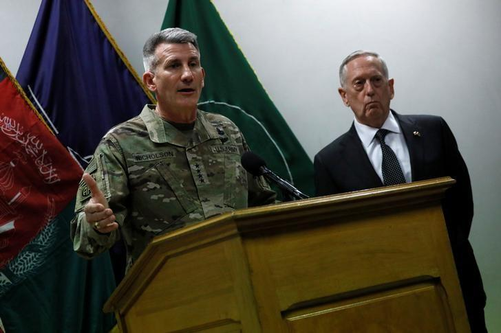 U.S. Defense Secretary James Mattis (R) and U.S. Army General John Nicholson (L), commander of U.S. Forces Afghanistan, hold a news conference at Resolute Support headquarters in Kabul, Afghanistan April 24, 2017. REUTERS/Jonathan Ernst/Files