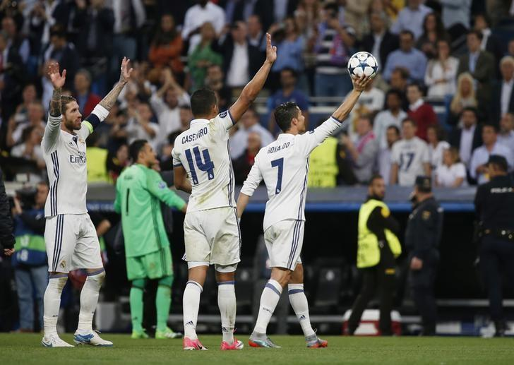 Football Soccer - Real Madrid v Bayern Munich - UEFA Champions League Quarter Final Second Leg - Estadio Santiago Bernabeu, Madrid, Spain - 18/4/17 Real Madrid's Cristiano Ronaldo celebrates with the matchball and team mates after scoring a hat trick at the end of the match  Reuters / Susana Vera Livepic