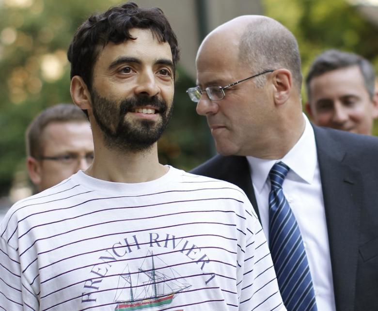 FILE PHOTO - Former Goldman Sachs computer programmer Sergey Aleynikov (L) smiles as he exits Manhattan Criminal Court in New York, August 9, 2012.  REUTERS/Brendan McDermid/File Photo