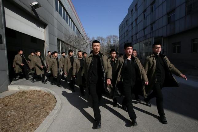 4月24日、中国の大規模な経済圏構想「一帯一路」に絡む案件を受注しようと、国内外のセキュリティー会社がしのぎを削っている。写真は北京市で3月撮影 (2017年 ロイター/Jason Lee)