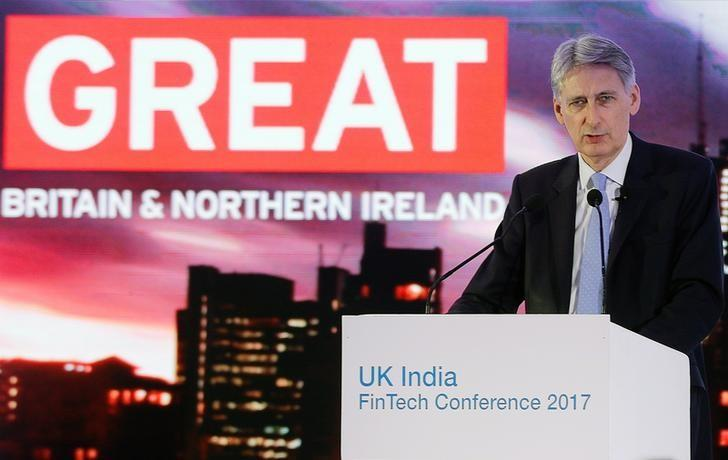Britain's Chancellor of the Exchequer Philip Hammond speaks at the UK-India Fintech Conference in Mumbai, April 5, 2017. REUTERS/Shailesh Andrade/Files