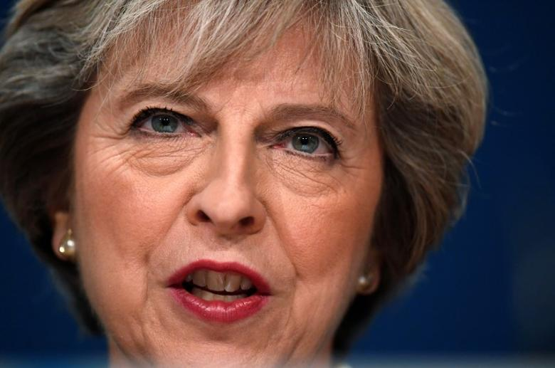Britain's Prime Minister Theresa May speaks at the annual Conservative Party Conference in Birmingham, Britain, October 2, 2016. REUTERS/Toby Melville/File Photo