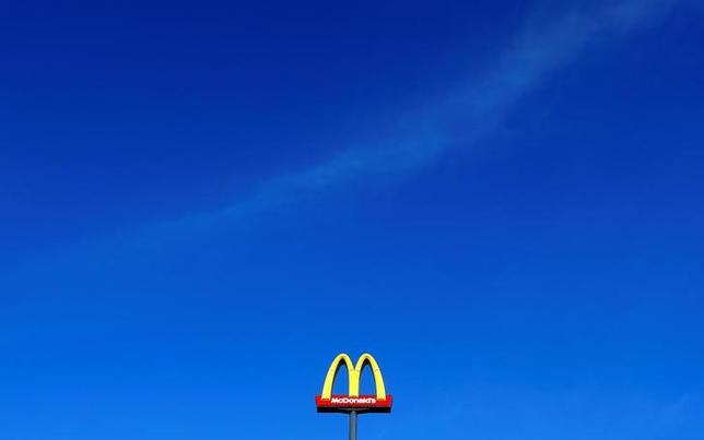 FILE PHOTO: A sign for the U.S. fast food restaurant chain McDonald's is seen outside one of their restaurants in Sint-Pieters-Leeuw, near Brussels, Belgium December 3, 2015. REUTERS/Yves Herman/File Photo