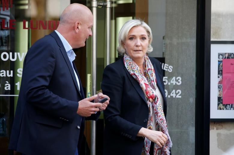 Marine Le Pen (R), French National Front (FN) political party leader and candidate for French 2017 presidential election, and her bodyguard Thierry Legier leave the haidresser in front of her campaign headquarters in Paris, France, April 24, 2017. REUTERS/Charles Platiau