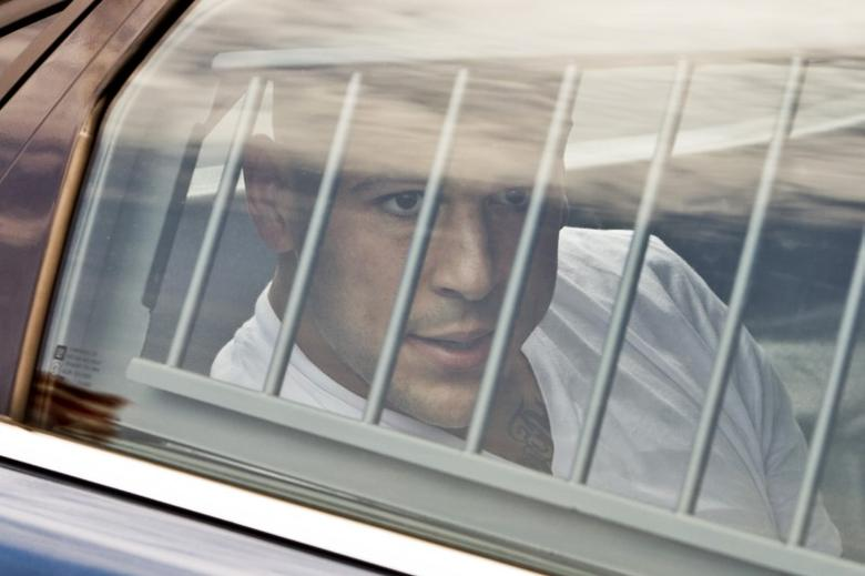 New England Patriots tight end Aaron Hernandez is led out of the North Attleborough police station after being arrested June 26, 2013.  REUTERS/Dominick Reuter
