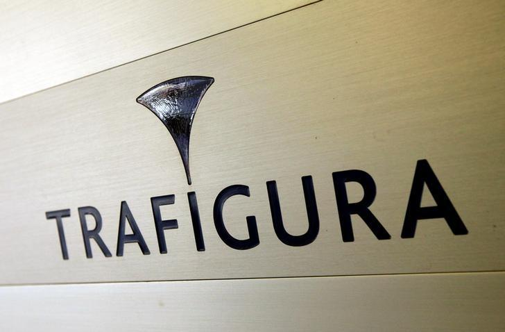 Trafigura logo is pictured in the company entrance in Geneva, Switzerland March 11, 2012. REUTERS/Denis Balibouse/File Photo