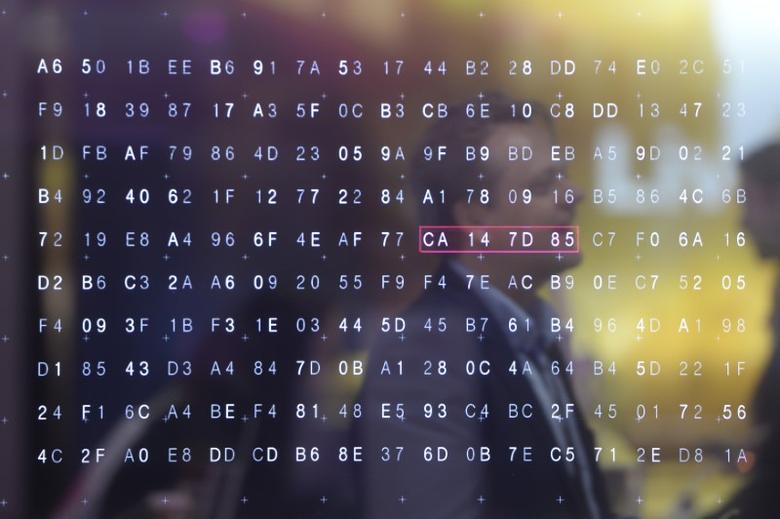 A man walks past a display of hexadecimal code in a file photo.  REUTERS/Nigel Treblin