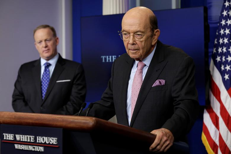 U.S. Commerce Secretary Wilbur Ross speaks next to Press Secretary Sean Spicer about new tariffs on Canadian softwood lumber from the White House in Washington, U.S. April 25, 2017. REUTERS/Yuri Gripas