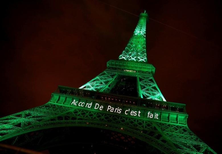 The Eiffel tower is illuminated in green with the words ''Paris Agreement is Done'', to celebrate the Paris U.N. COP21 Climate Change agreement in Paris, France, November 4, 2016. REUTERS/Jacky Naegelen/File Photo