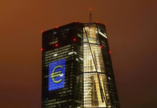 FILE PHOTO: The headquarters of the European Central Bank (ECB) are illuminated with a giant euro sign at the start of the ''Luminale, light and building'' event in Frankfurt, Germany, March 12, 2016.   REUTERS/Kai Pfaffenbach/File Photo