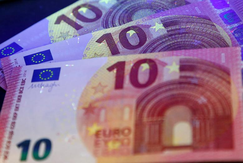 FILE PHOTO: 10 Euro banknotes are pictured under ultraviolet light during a news conference at the headquarters of Bundesbank in Frankfurt, Germany, May 7, 2014.  REUTERS/Ralph Orlowski/File Photo
