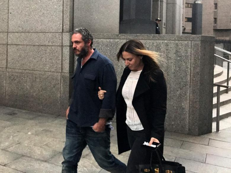 Joseph Meli and his wife, Jessica Meli, exit U.S. Federal Court in Manhattan, New York, U.S., January 27, 2017, after Meli and Steven Simmons were charged with running a criminal Ponzi scheme that swindled investors in a purported ticket-reselling business for popular events, such as Adele concerts and the smash Broadway musical ''Hamilton''. REUTERS/Nate Raymond