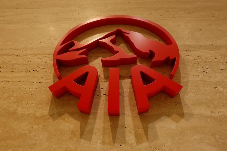 FILE PHOTO: The logo of AIA is displayed at its office in Hong Kong, China February 24, 2017.      REUTERS/Bobby Yip/File Photo