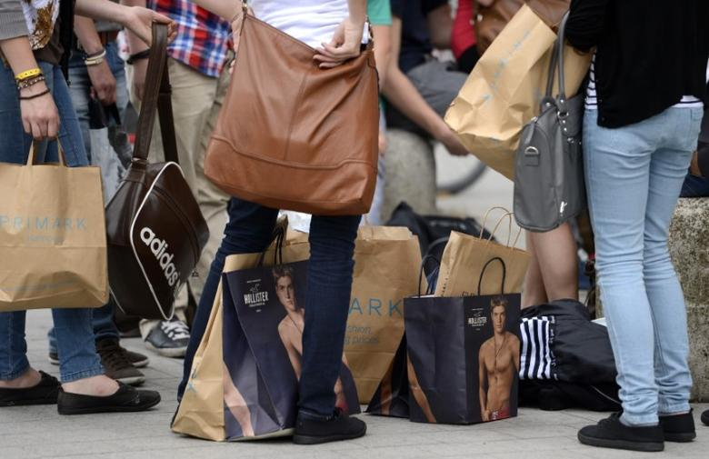 File photo of shoppers resting with their purchases in downtown Hanover June 19, 2012. REUTERS/Fabian Bimmer/Files
