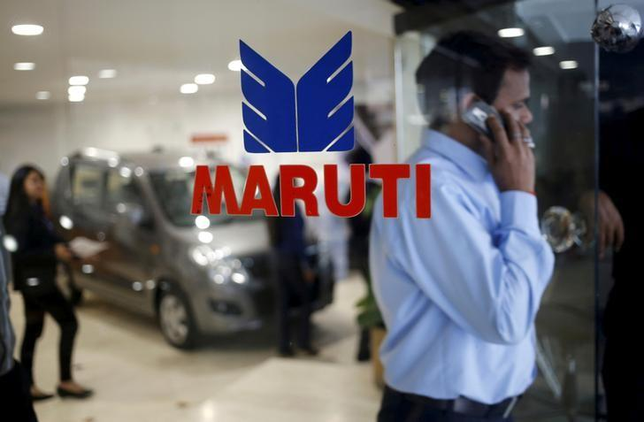 A man speaks on his mobile phone as he exits a glass door with the logo of Maruti Suzuki India Limited at a showroom in New Delhi, India, February 29, 2016. REUTERS/Anindito Mukherjee/File Photo